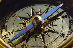 Old style gold compass. Closeup stock photo