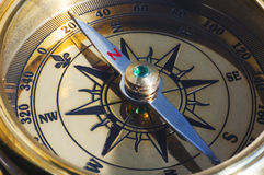 Old style gold compass. Closeup Stock Images