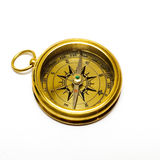 Old style gold compass. On white background royalty free stock images