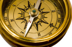 Old style gold compass. On white background royalty free stock photography