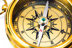 Old style gold compass. On white background royalty free stock image