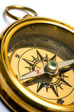 Old style gold compass. On white background royalty free stock photo