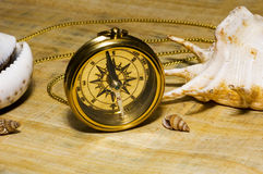 Old style gold compass. On papyrus background stock photos