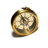 Old style gold compass. On white background royalty free stock photos