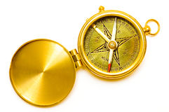 Old style gold compass Stock Images
