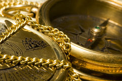 Old style gold compass & calendar. On closeup royalty free stock photos