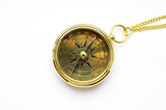 Old style gold compass with chain. On white background royalty free stock photography