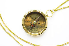 Old style gold compass with chain. On white background royalty free stock image