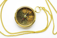 Old style gold compass with chain. On white background royalty free stock photos