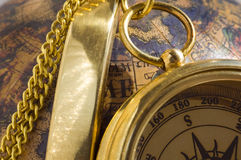 Old style gold compass & globe. Closeup royalty free stock photography