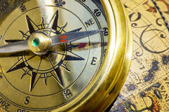 Old style gold compass & globe. Closeup stock photo