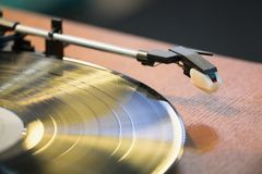 Old style gramophone. And black vinyl disk Stock Photo