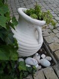 Old-style greek amphora laying on earth.  Stock Photography
