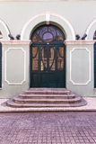 Old style green door with stair at vintage building Royalty Free Stock Images