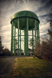 Old Style Green Water Tower Stock Photo