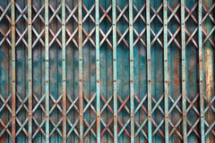 Old style grunge metal blue door with rusty. Royalty Free Stock Photo
