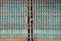 Old style grunge metal blue door with rusty. Royalty Free Stock Image