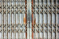 Old style grunge metal door with rusty Stock Photography