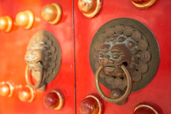 An old style handle knocker of the Chinese Temple Royalty Free Stock Photo
