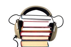 Old style headphones and books. Old style headphones listen audio books Royalty Free Stock Photography