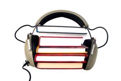 Old style headphones and books. Old style headphones listen audio books Stock Photos