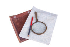 Old-style home-made map with magnifier, pencil and leather case Royalty Free Stock Photography