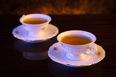 Old-style image with two cups of tea Royalty Free Stock Image