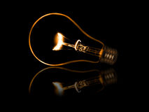 Old style incandescent bulbs. Glowing yellow light bulb as inspiration concept Royalty Free Stock Photos