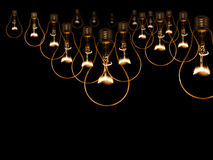 Old style incandescent bulbs. Glowing yellow light bulb as inspiration concept Royalty Free Stock Images