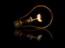 Old style incandescent bulbs. Glowing yellow light bulb as inspiration concept Stock Photo