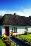Old Style Irish Cottage Adare Co. Limerick. On a sunny summers day Royalty Free Stock Image