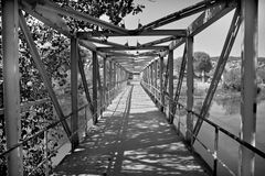 Old style iron river bridge Royalty Free Stock Photo