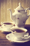 Old-style kettle with two cups of coffee vintage effect Royalty Free Stock Photography