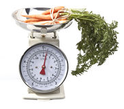 Old style kitchen scales with carrots Stock Photos
