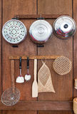 Old style kitchenware. In Thailand on wood wall Stock Photography