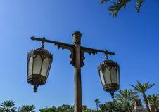 Old style lamp post under blue sky stock image