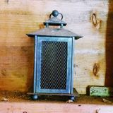 Old style lantern. Old style candle lantern indoors or outdoors Royalty Free Stock Photo
