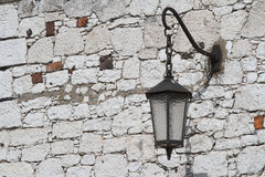 Old-style lantern on wall of building. Horizontal Royalty Free Stock Photos