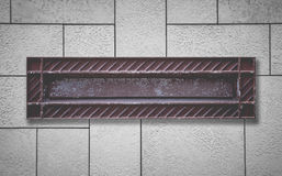 Old style letterbox and concrete wall Stock Image