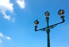Old Style Light Pole. And blue sky Royalty Free Stock Photography
