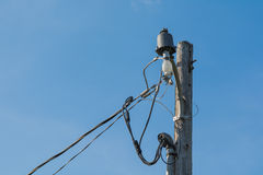 Old style Light post and electric pole Royalty Free Stock Photos