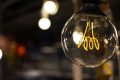 Old style lightbulb in a wearhouse. royalty free stock photos