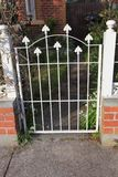 Old style locked gate in white Stock Image