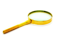 Old style magnifier. This is yellow metal old style magnifier glass Royalty Free Stock Photo
