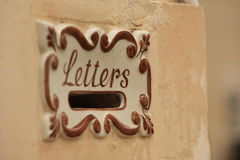 Old style mail box. A close-up of a mail box outside of a house in europe Stock Photography