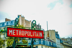 Old style Metro Sign in Paris with Architecture in background, France. During daytime Royalty Free Stock Images