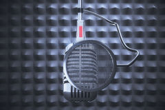 Old style microphone at grey background Stock Photos