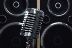 Old style microphone at speakers background Stock Images