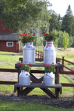 Old style milk canisters stock photography