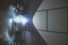 Old style movie camera with grey wall. Close up Stock Photography